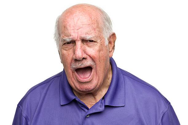 Portrait of a senior man on a white background.